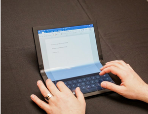 """Source: Sarah Tew, """"Lenovo foldable ThinkPad X1 prototype: A big screen that bends - bigger than the Samsung Galaxy Fold, this 13-inch tablet folds into a laptop shape for typing and productivity,"""" accessed 15 May 2019, https://www.cnet.com/news/the-thinkpad-x1-foldable-prototype-is-a-big-screen-that-bends/."""