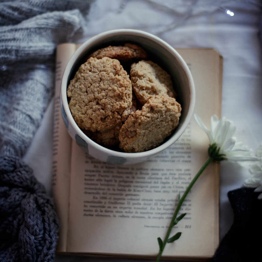 bowl of biscuits sitting on a book
