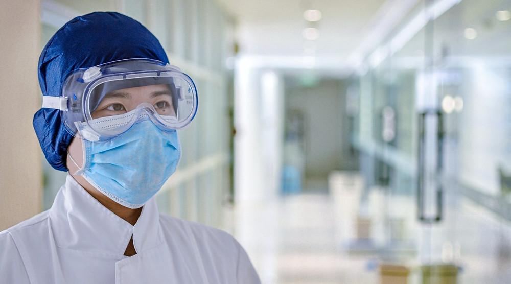 Doctor wearing PPE in hospital hallway