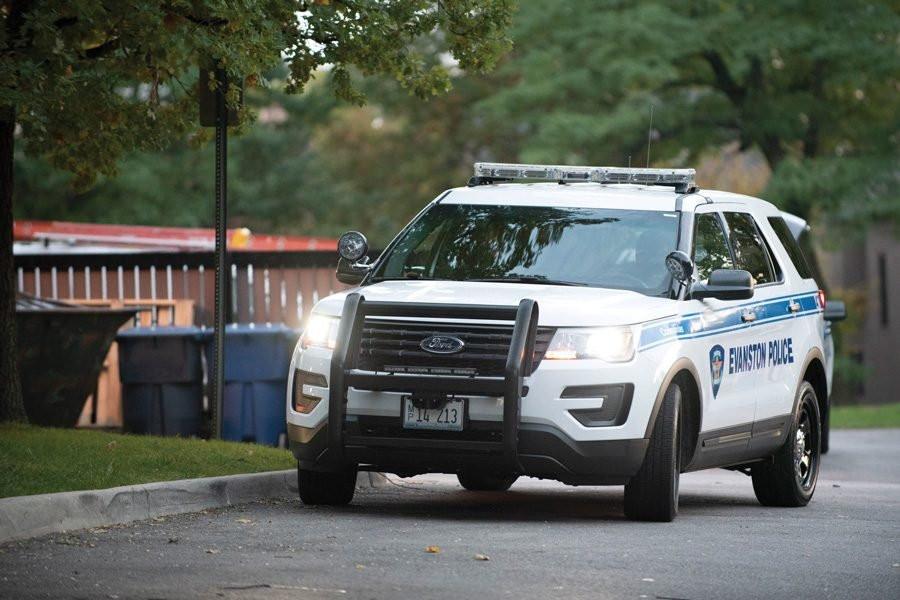 Evanston police officer parked outside house.