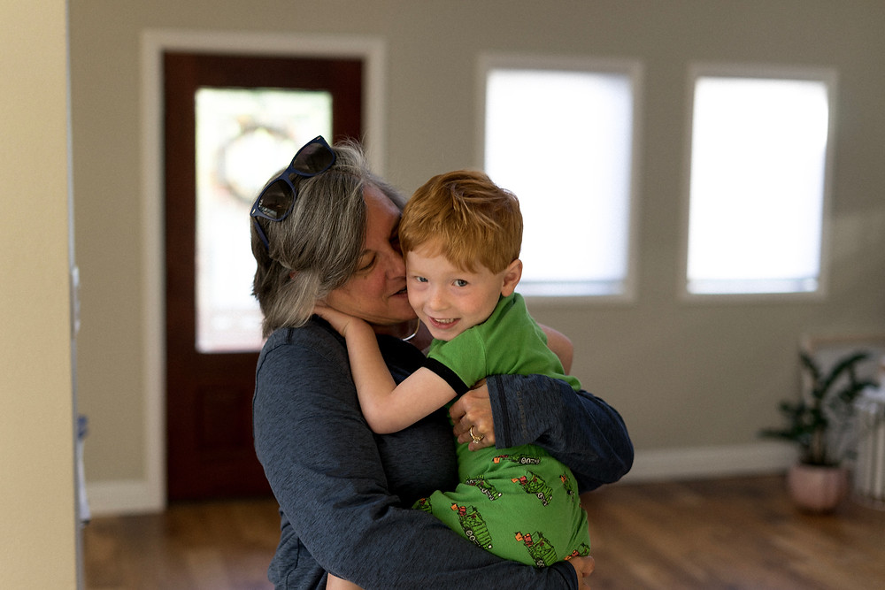 Portrait of a young boy in his grandma's arms