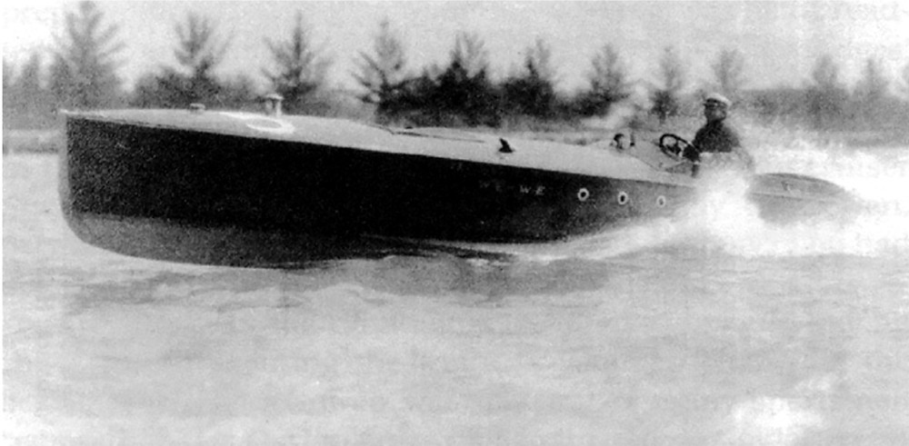 Black and white photo of Carl Fisher speeding along Miami's