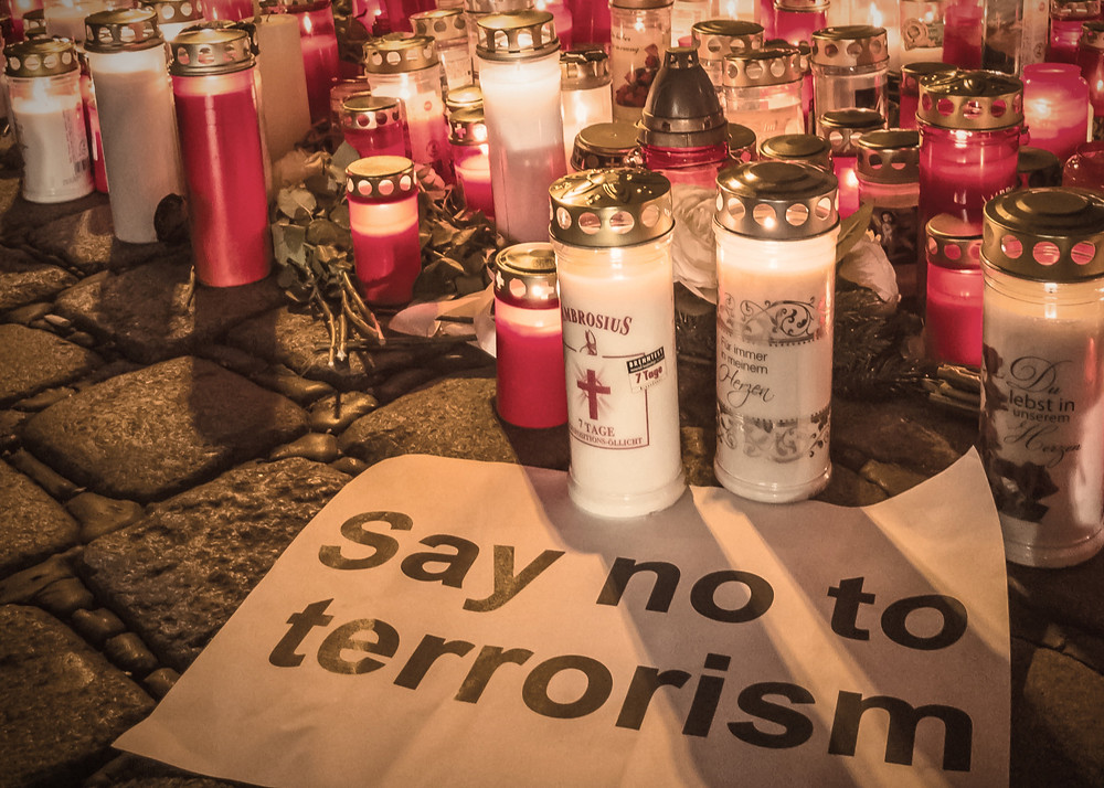 Candles in red an white at the location of the terror attack in Vienna in Austria on 2 November 2020