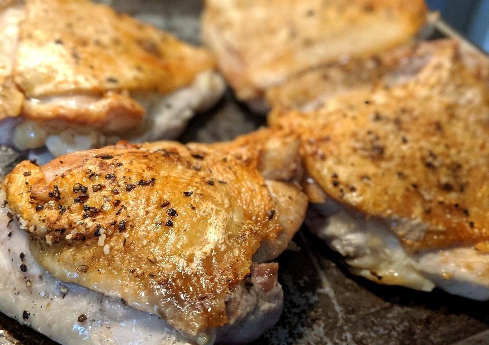 rendered chicken thighs with crispy skin