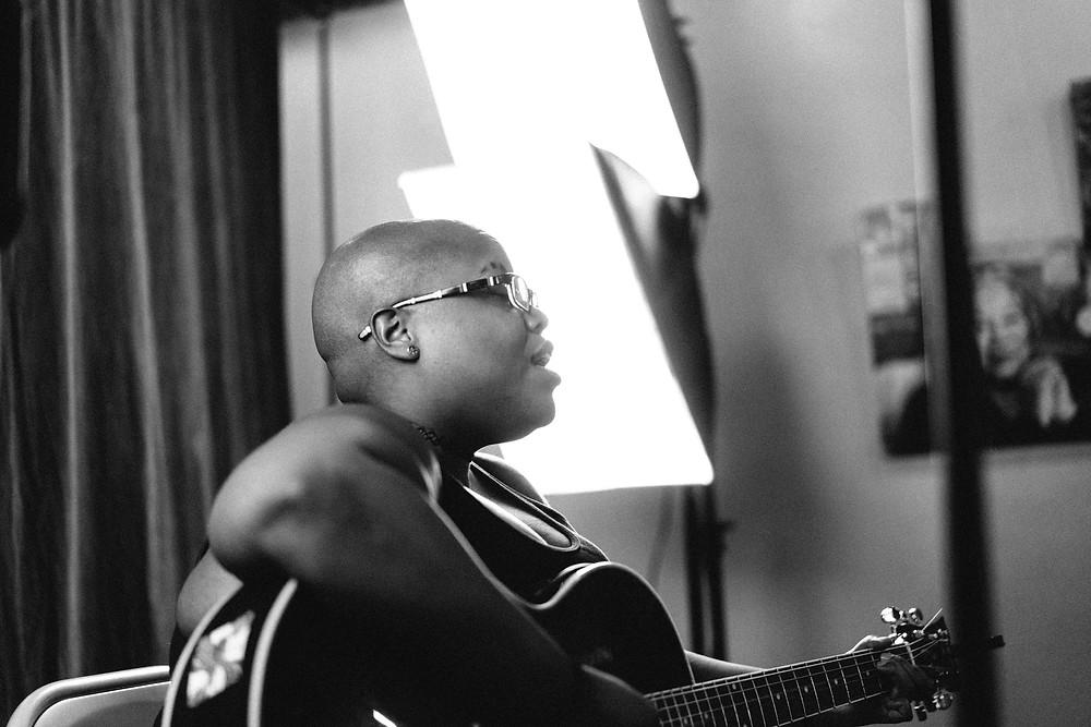 Singer from the side, backlit