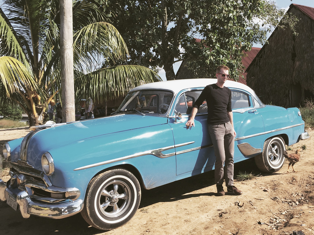 Posing with a vintage car and chicken in Vinales, Cuba