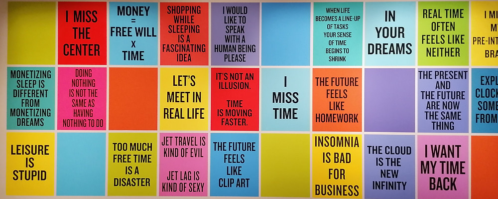 Mural of words - Let's meet in real life, the future feels like clip art, insomnia is bad for business, I miss time, the future feels like homework, in your dreams, too much free time is a disaster, leisure is stupid