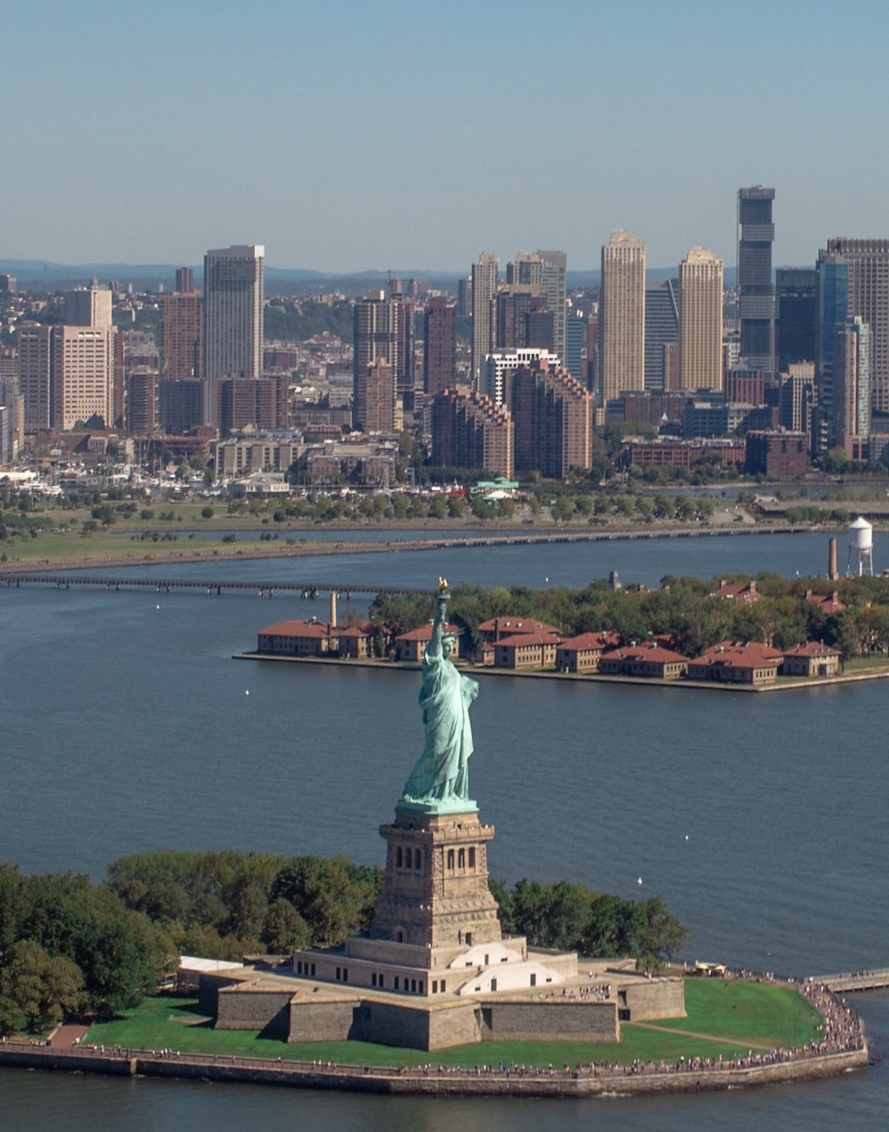 View of Ellis Island and the Statue of Liberty with skyscrapers in the background
