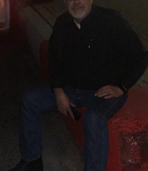 Russ sitting on a massive curb in Galveston TX