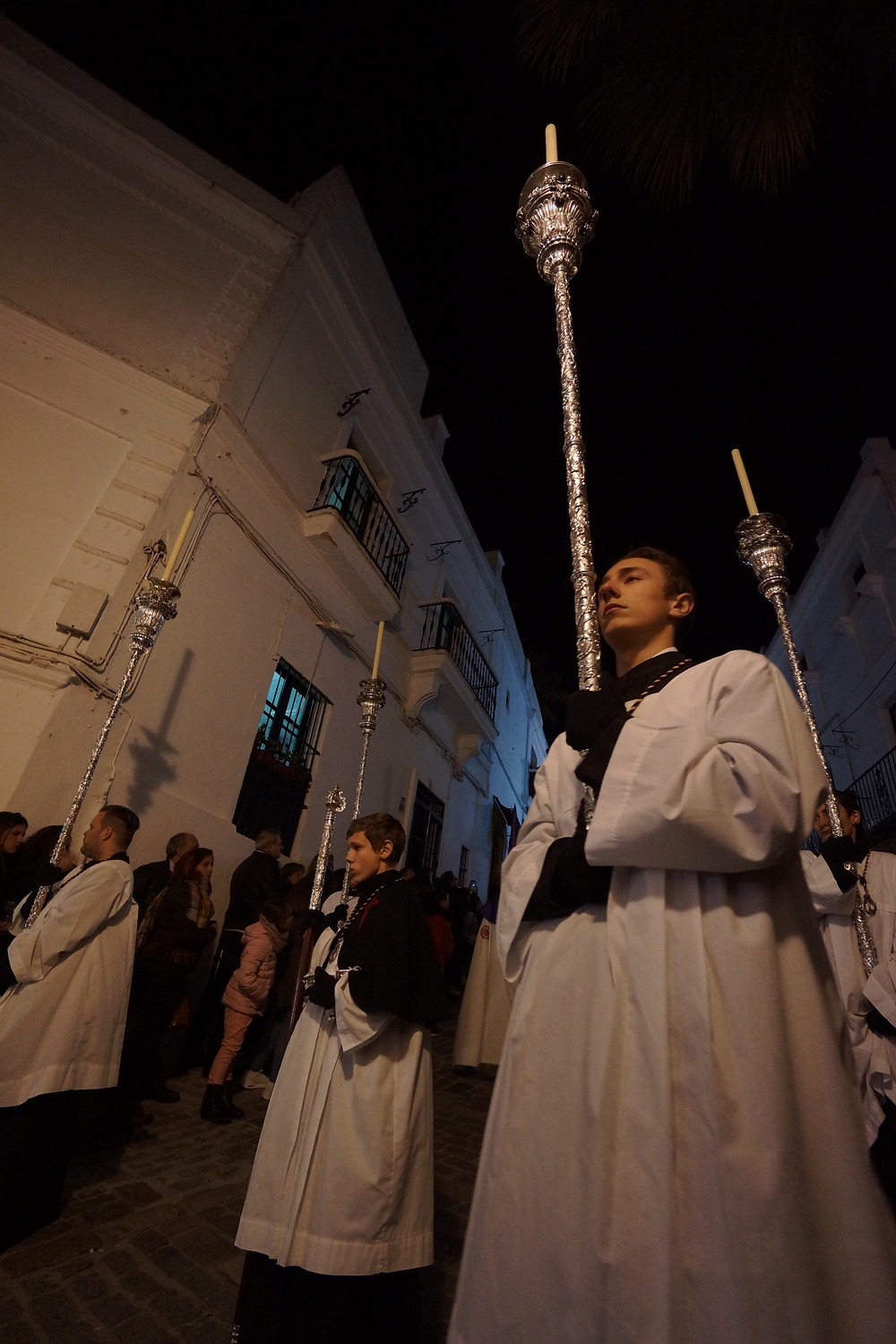 One of several Semana Santa processions - participants in white robes