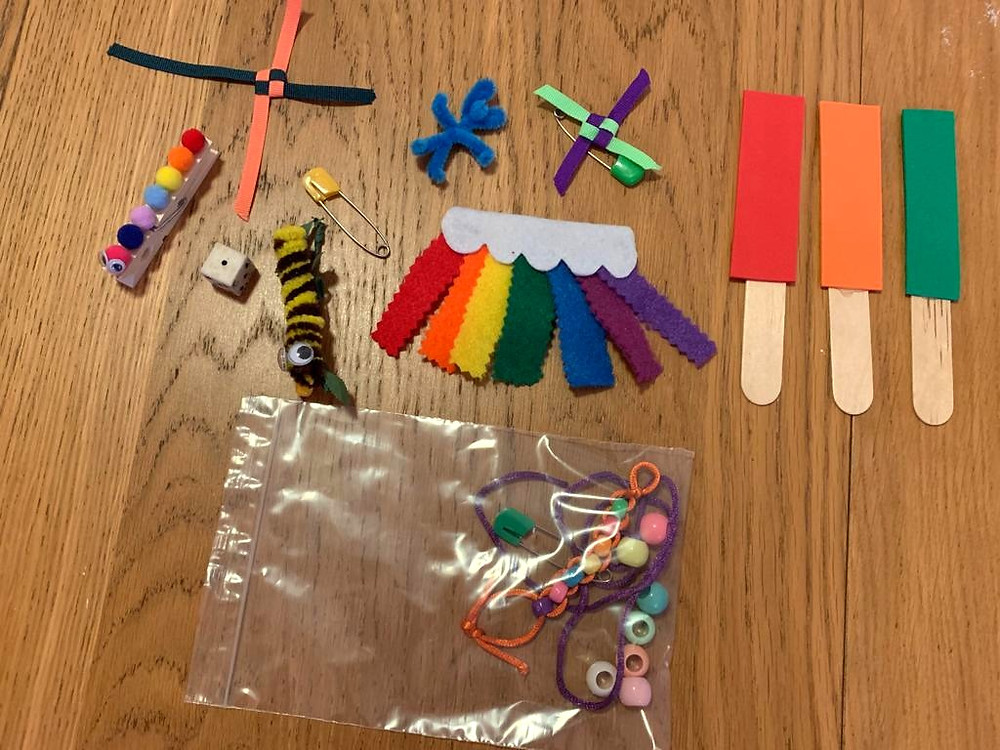 Craft packs with felt, beads, string, ribbon, safety pins and assembled rainbow craft
