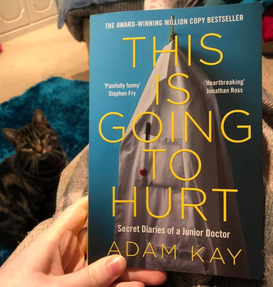 Lois Kingscott holds the book This is Going to Hurt by Adam Kay