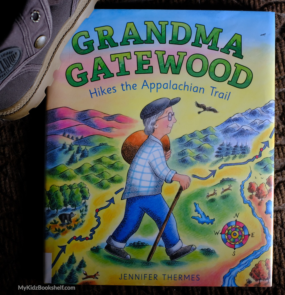 Grandma Gatewood Hikes the Appalachian Trail picture book cover of grey-haired woman hiking with mountains behind her