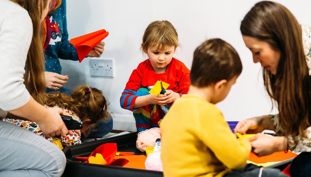 Children using scissors in a Phonics Fox lesson