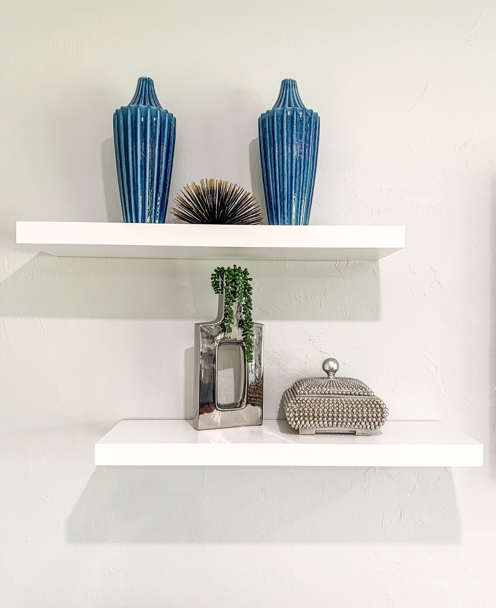 staggered floating shelves with modern coastal decor