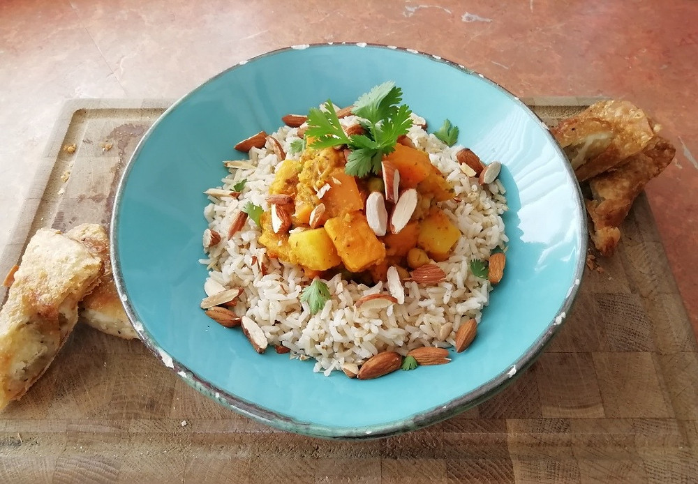 a super healthy vegetarian sweet potato curry with brown basmati rice