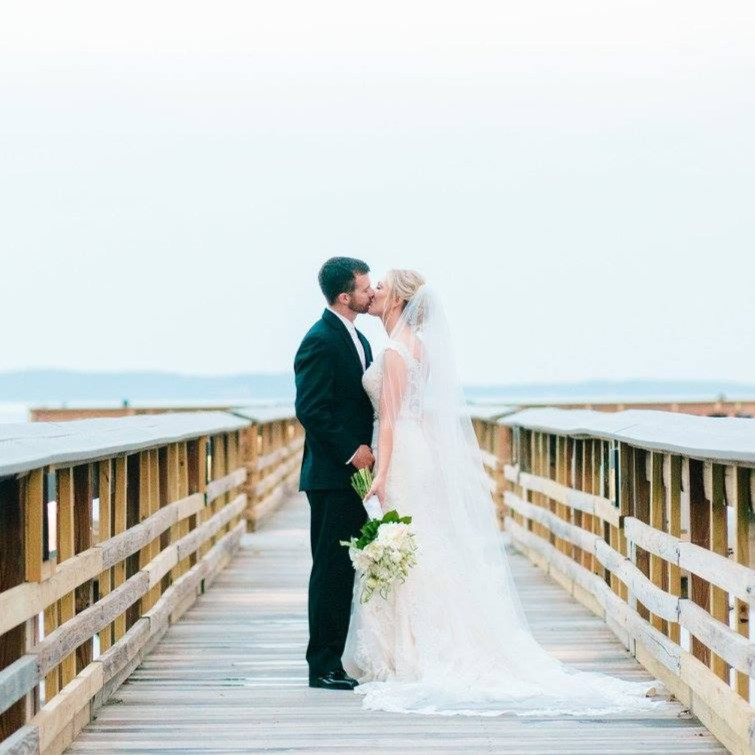 Beautiful Bride and Groom photoshoot on a pier.