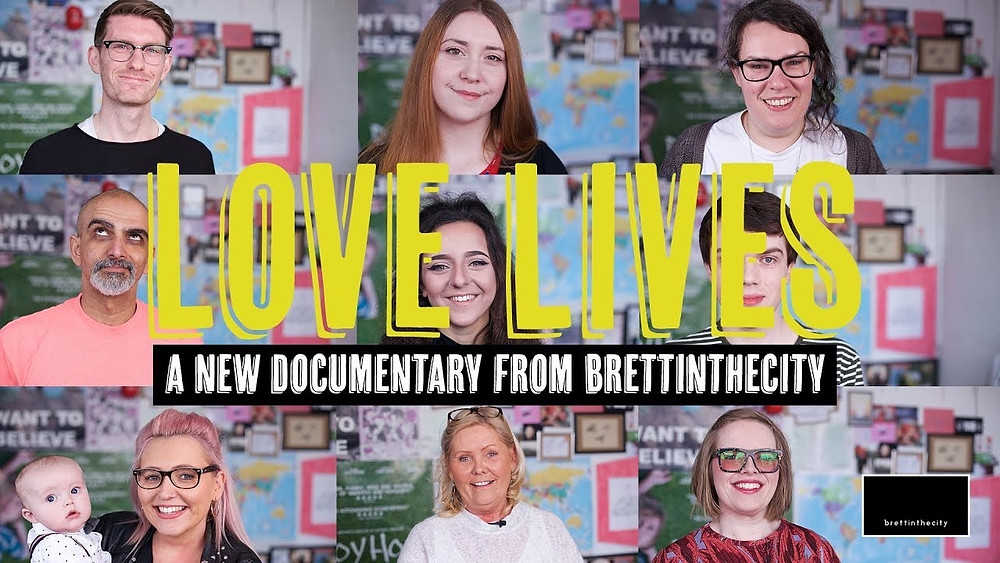 Nine individuals who appear in the documentary are placed in columns/rows to cover the entire background of the film poster. The title 'Love Lives' is written in bold, yellow text across the middle of the image.