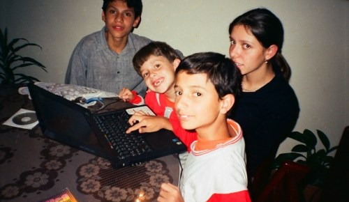 Me (middle with my front teeth missing) experiencing a computer for the first time at age 5, 1998.