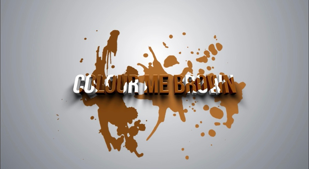 Colour Me Brown poster featuring the words colour me brown in white on a white background with brown paint thrown over them.