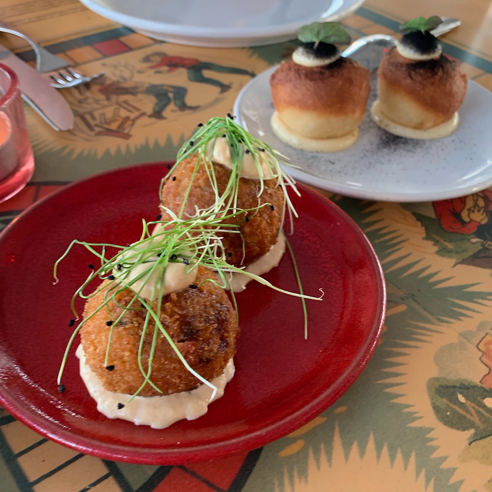 Foreground: Veal croquettes Background: Duck donuts