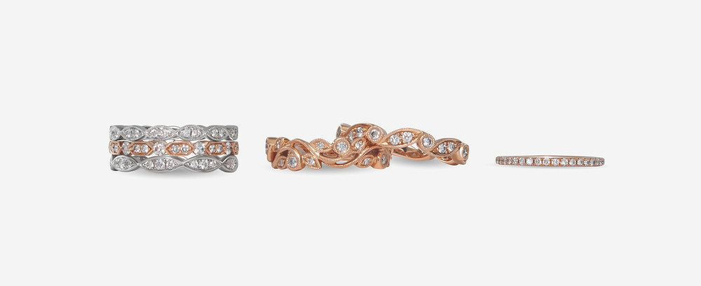 white gold and rose gold stacking bands with natural diamonds filigree and beading details on white background
