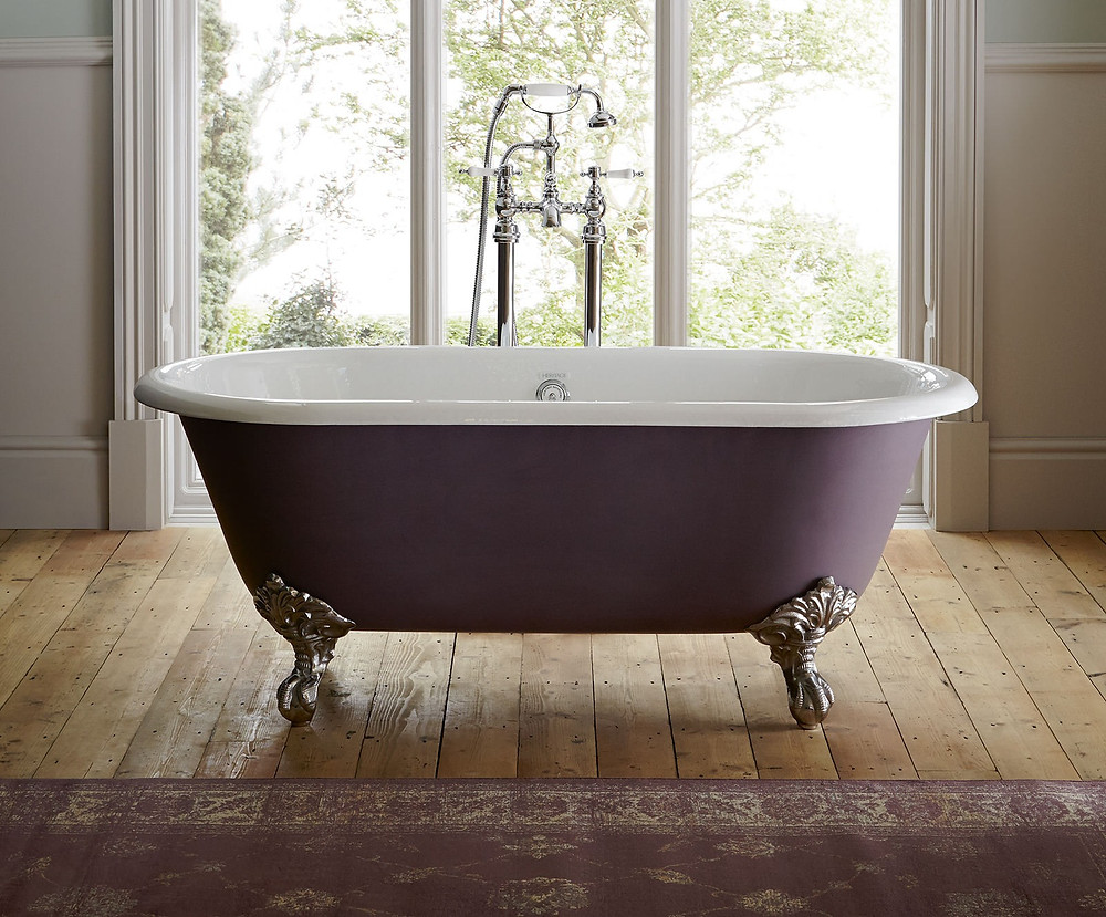 Burgundy freestanding bath with ornate claw feet