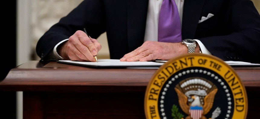 President Biden signing executive order to restore collective bargaining rights.