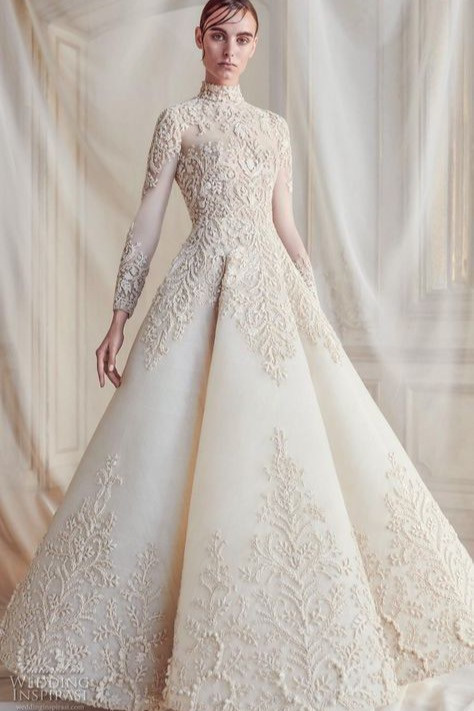 Princely wedding dress with lace sleeves, ideal for conjuring festive magic.