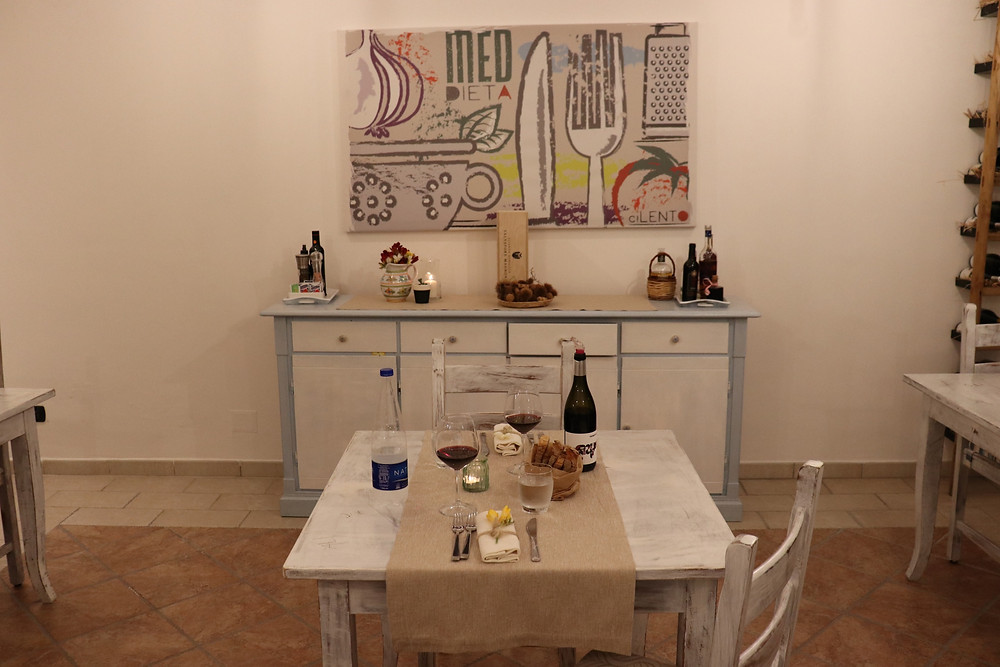 Dining room set up for dinner at B&B Baia di Trentova Cilento Italy