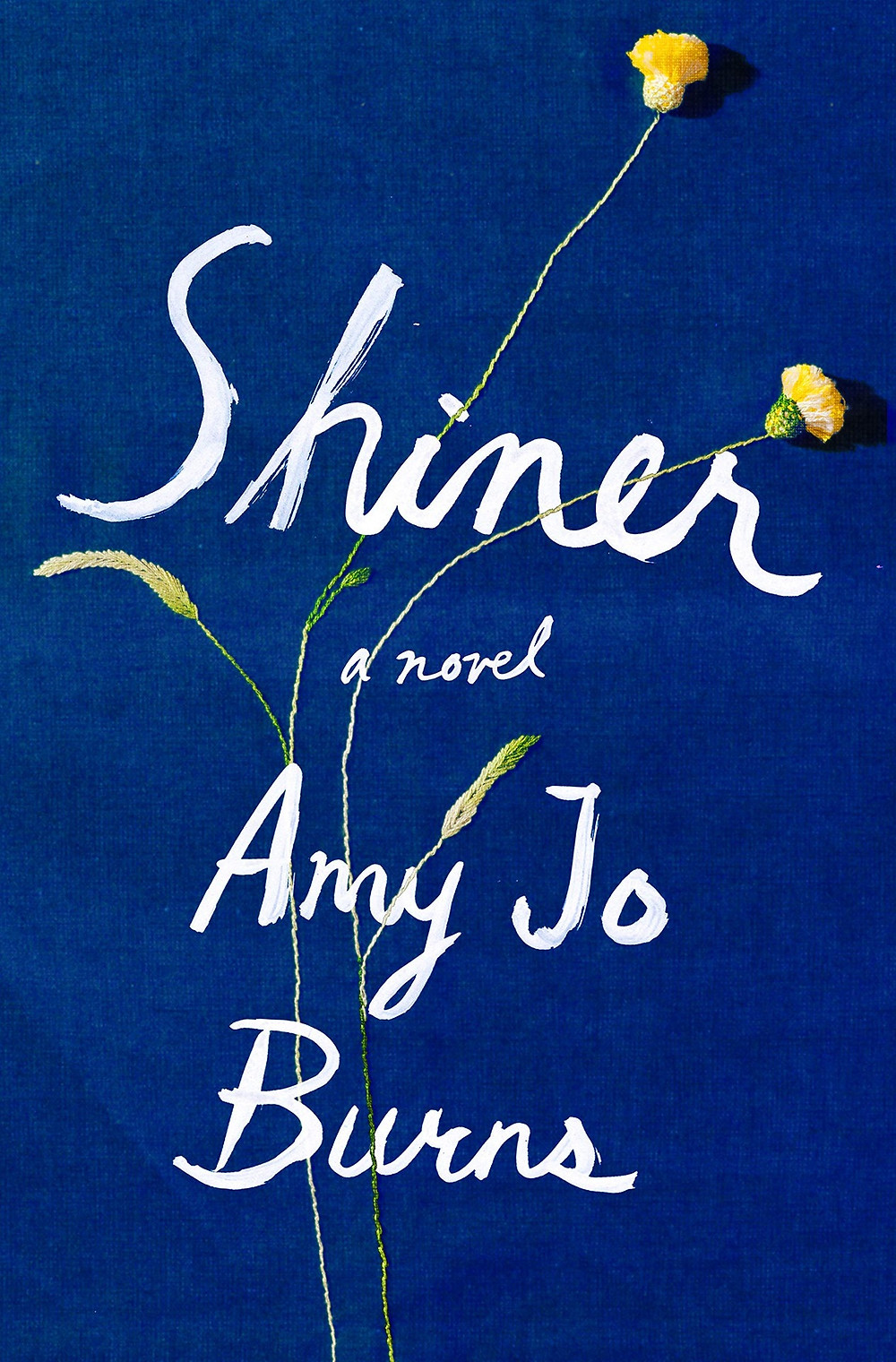 Shiner by Amy Jo Burns. Blue bok cover with small yellow flowers and white font. Amy Jo Burns is the author of the memoir Cinderland. Her writing has appeared in The Paris Review Daily, Tin House, Ploughshares, Gay Magazine, Electric Literature, Literary Hub, and The Paris Review Daily, and the anthology Not That Bad. Thebookslut book reviews the book slut.On a lush mountaintop trapped in time, two women vow to protect each other at all costs-and one young girl must defy her father to survive. An hour from the closest West Virginia mining town, fifteen-year-old Wren Bird lives in a cloistered mountain cabin with her parents. They have no car, no mailbox, and no visitors-except for her mother's lifelong best friend. Every Sunday, Wren's father delivers winding sermons in an abandoned gas station, where he takes up serpents and praises the Lord for his blighted white eye, proof of his divinity and key to the hold he has over the community, over Wren and her mother. But over the course of one summer, a miracle performed by Wren's father quickly turns to tragedy. As the order of her world begins to shatter, Wren must uncover the truth of her father's mysterious legend and her mother's harrowing history and complex bond with her best friend. And with that newfound knowledge, Wren can imagine a different future for herself than she has been told to expect. Rich with epic love and epic loss, and diving deep into a world that is often forgotten but still part of America, Shiner reveals the hidden story behind two generations' worth of Appalachian heartbreak and resolve. Amy Jo Burns brings us a smoldering, taut debut novel about modern female myth-making in a land of men-and one young girl who must ultimately open her eyes. Product Details Price: $27.00  $24.30 Publisher: Riverhead Books Published Date: May 05, 2020 Pages: 272 Dimensions: 6.0 X 0.69 X 9.0 inches | 1.0 pounds Language: English Type: Hardcover ISBN: 9780525533641 BISAC Categories: General Women
