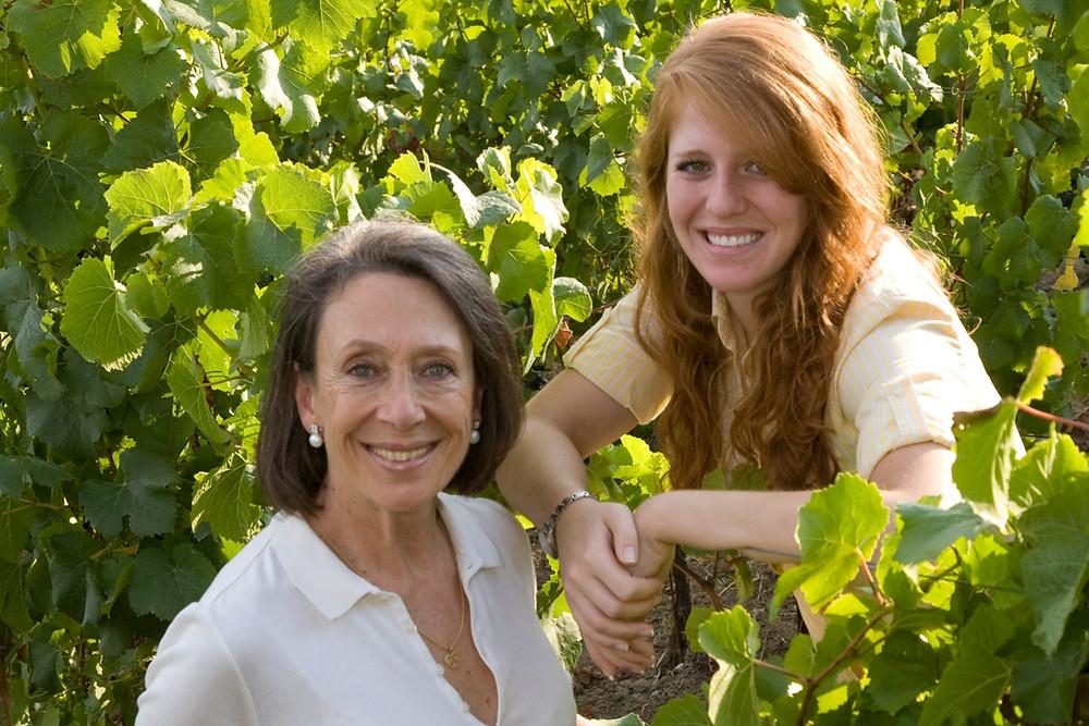Marimar Torres an Cristina Torres smiling in their vineyards in Sebastopol, California at Marimar Estate