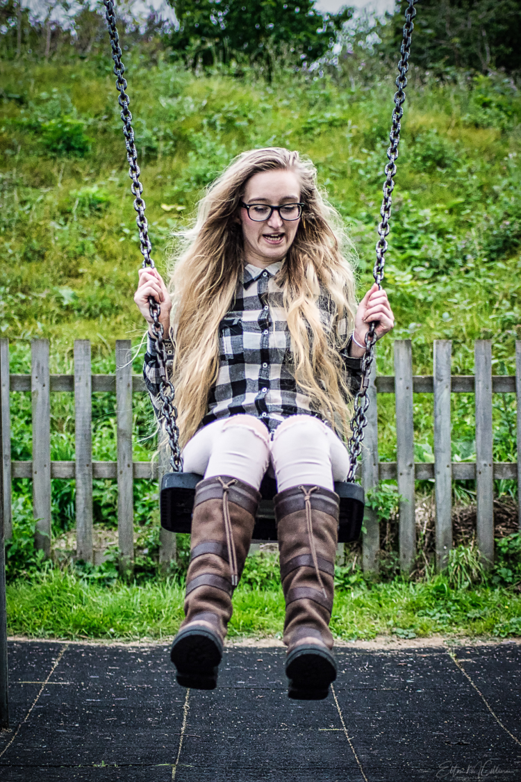 A young blonde woman on a swing. Portrait photographer. Commercial photographer. Travel photographer. Travel photography. Travel blog. Road trip. roadtrip4charity. Elton Cilliers. EmC Photography