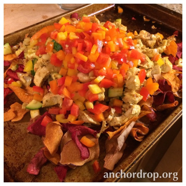 veggie chips piled high with chicken and vegetables