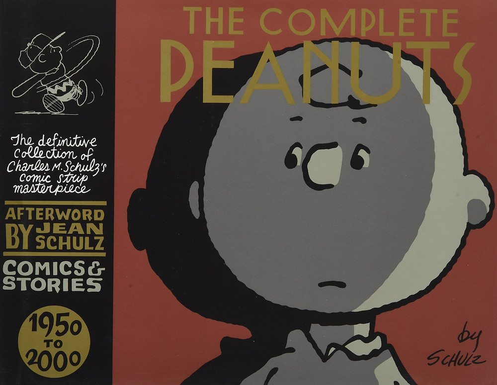 This is a cover for The Complete Peanuts 1950-2000 Comics & Stories comic book collection. The image on the cover features Charlie Brown from the shoulders up.
