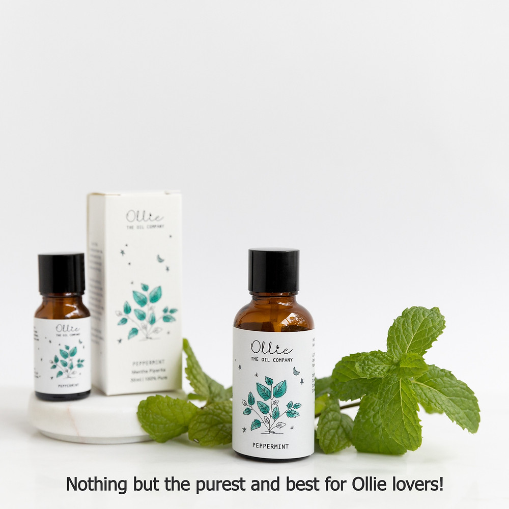 peppermint oil with packaging and mint leaves
