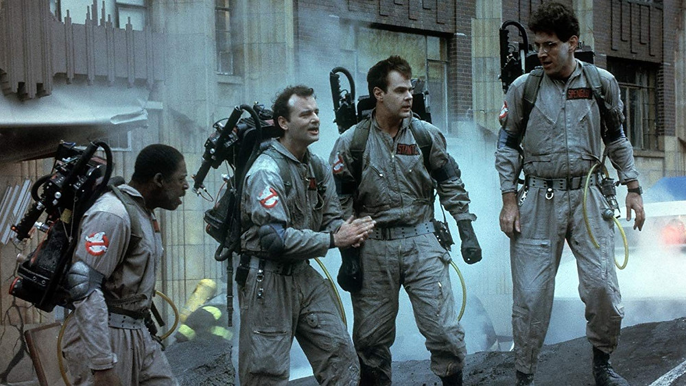 Four ghostbusters discussing