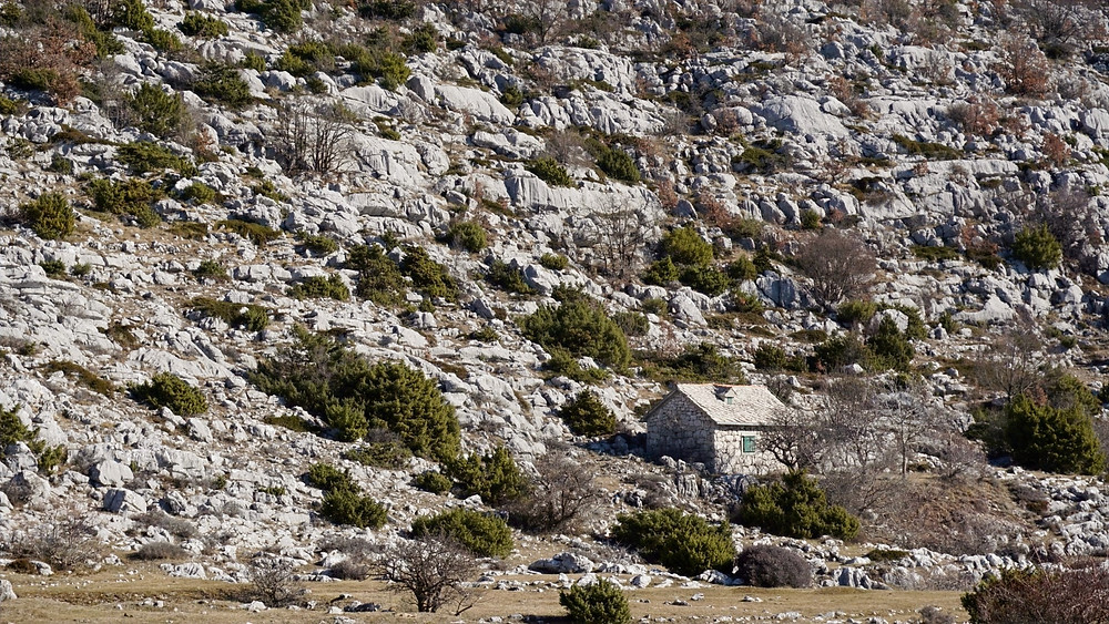 Old stone house blended into Biokovo hills in Croatia