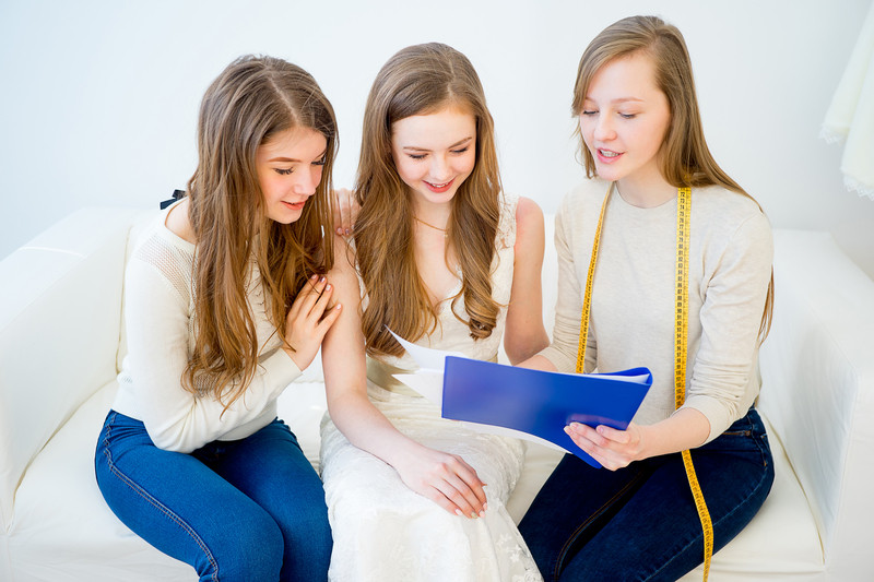A bride and bridesmaids discussing wedding plans