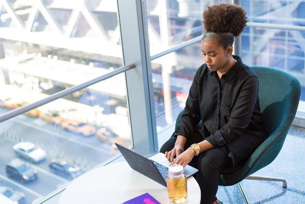 Beautiful African American woman working on laptop