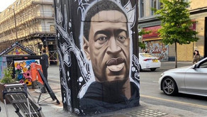 A George Floyd mural has appeared in the Northern Quarter