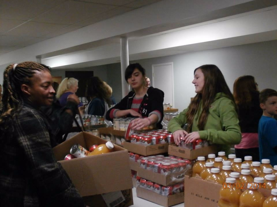 Handing out food at the bread of life food bank at Strong Tower Church in forest hill maryland.