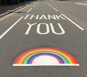 photo of a road with a rainbow sticker and thank you written across