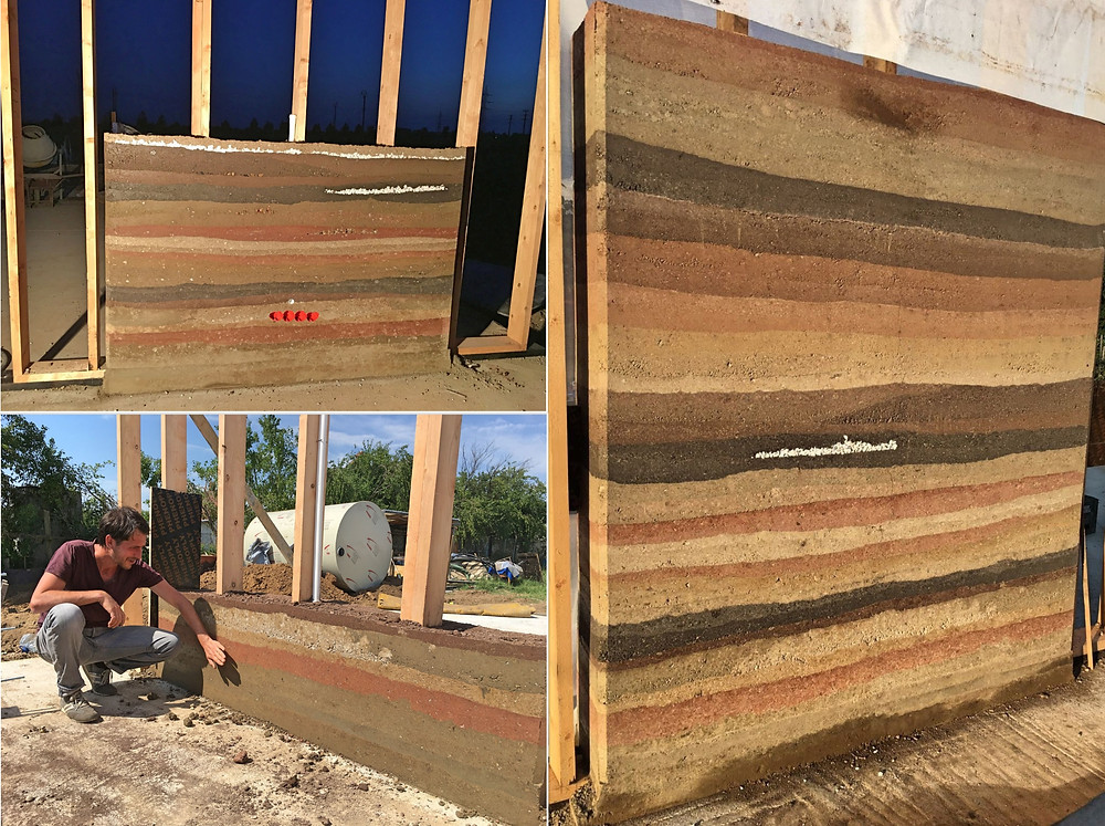 A rammed earth wall manufactured by us in our back yard. The mixture of compounds is compacted successively in a framework by 50% of its volume, resulting in a strong, resistant and durable wall.