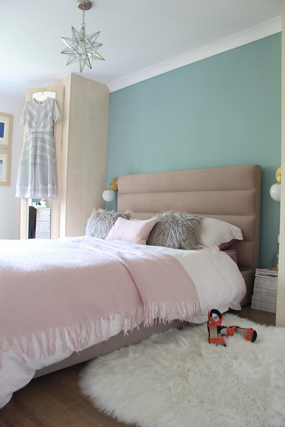 Wall colour IS Farrow & Ball DIX BLUE, pink headboard and a brass side lamp, feminine bedroom decor Jenny Kakoudakis
