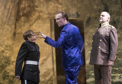 Heather Lowe as Sesto, James Laing as Tolomeo and Darren Jeffery as Achilla in Opera North's Giulio Cesare c Alastair Muir