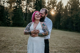 A couple laughing in the forest on their wedding day in Washington