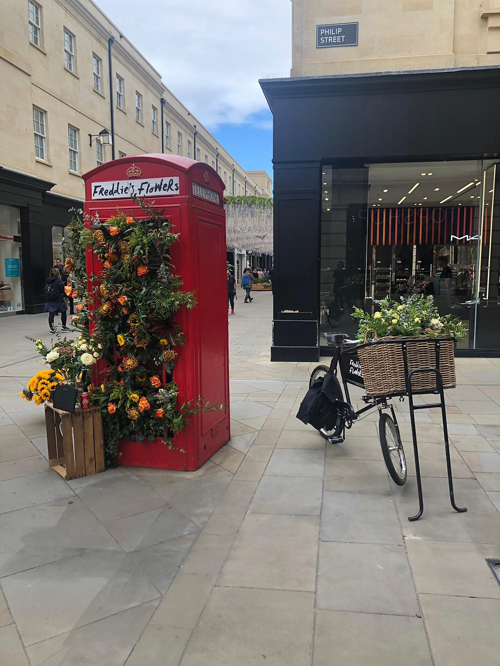 A red telephone box in Bath city centre turned into a flower stand
