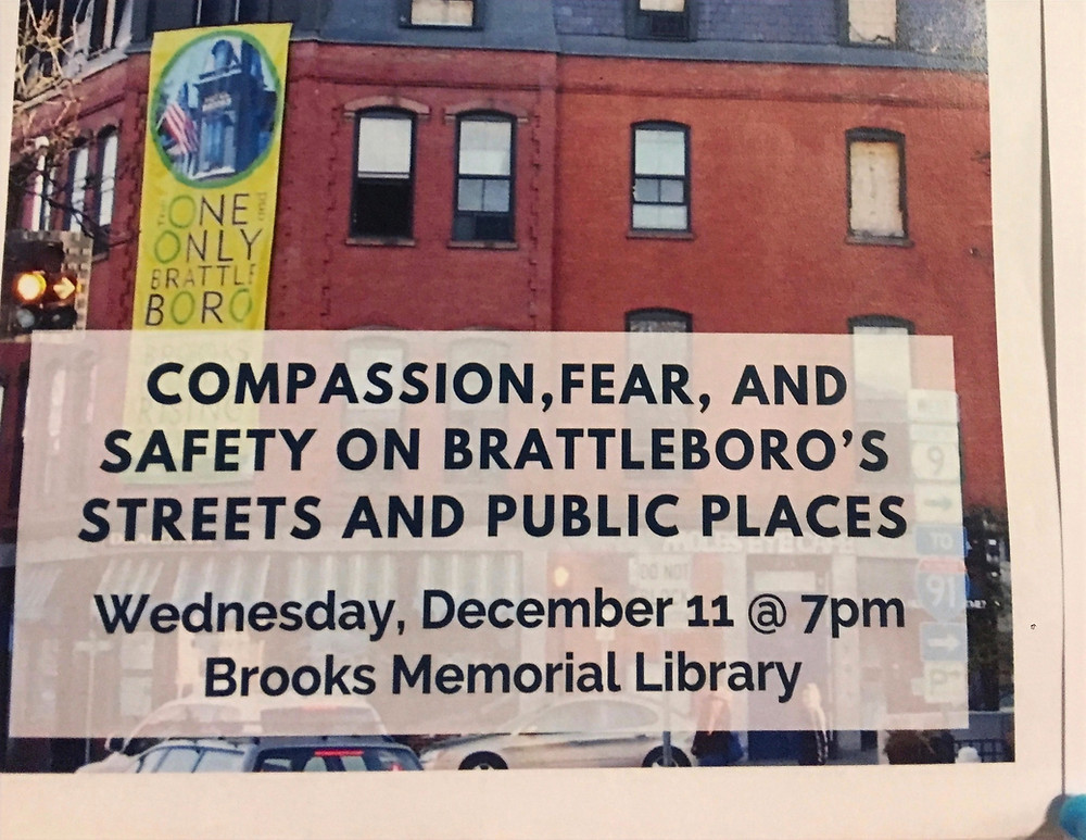 poster advertising talk on compassion and fear in downtown Brattleboro