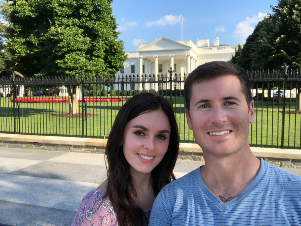 A young couple in front of the White House in Washington, DC